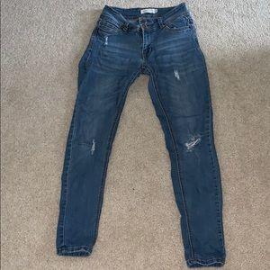 Lightly Distressed Medium Wash Skinny Jeans